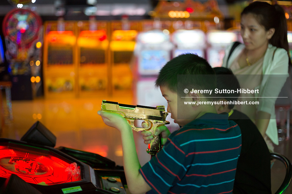 Amusement gaming arcade with shoppers, in Beijing, China, Saturday 2nd June 2012.