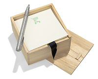 wooden box of paper for a grocery list with pen