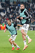 Juventus Defender Leonardo Bonucci and Juventus Midfielder Miralem Pjanic in warm up during the Champions League Group H match between Juventus FC and Manchester United at the Allianz Stadium, Turin, Italy on 7 November 2018.