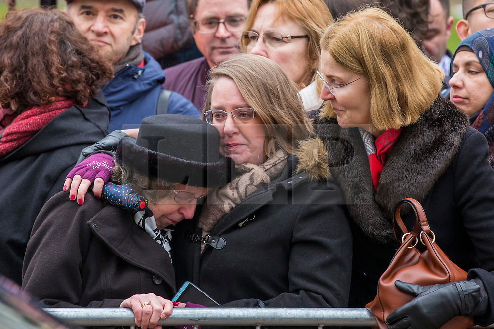 © Licensed to London News Pictures. 31/03/2018. Cambridge, UK. Viv Riches (L), one of Stephen Hawking's former carers, cries outside the funeral of Stephen Hawking at Church of St Mary the Great in Cambridge, Cambridgeshire. Professor Hawking, who was famous for ground-breaking work on singularities and black hole mechanics, suffered from motor neurone disease from the age of 21. He died at his Cambridge home in the morning of 14 March 2018, at the age of 76. Photo credit: Rob Pinney/LNP