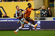 Burnley defender Scott Arfield fouls Wolverhampton Wanderers midfielder Sheyi Ojo during the Sky Bet Championship match between Wolverhampton Wanderers and Burnley at Molineux, Wolverhampton, England on 7 November 2015. Photo by Alan Franklin.