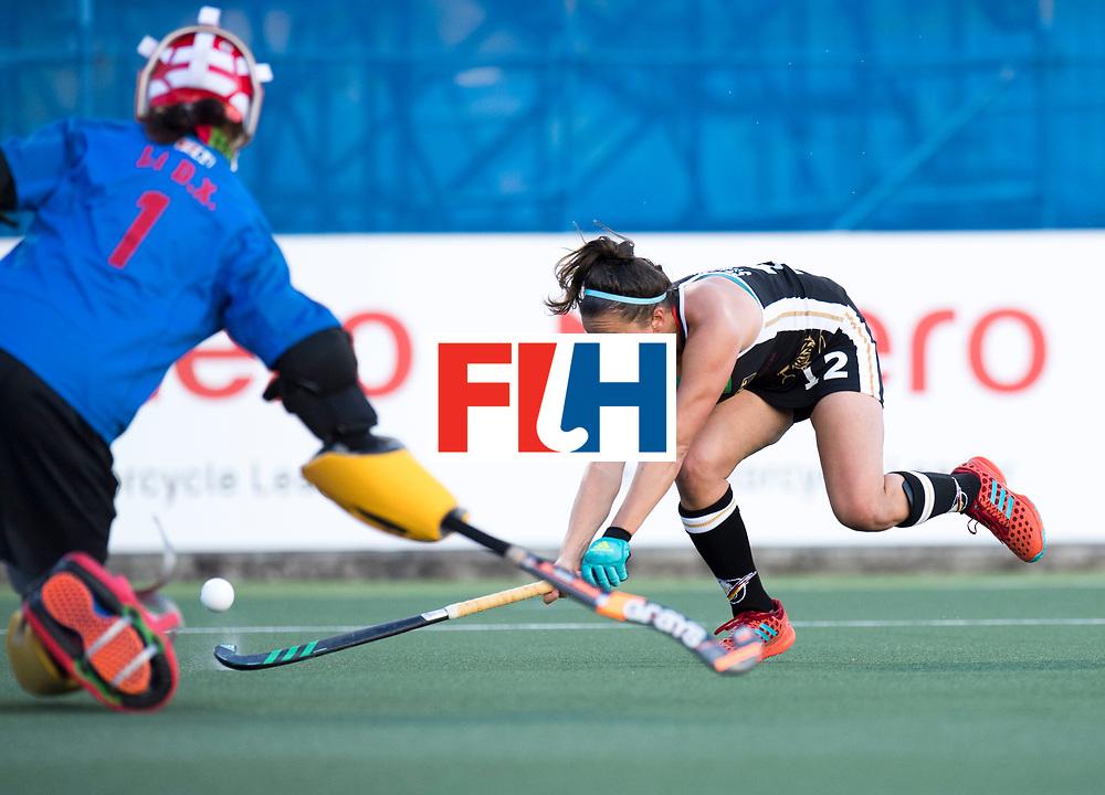AUCKLAND - Sentinel Hockey World League final women<br /> Match id 10297<br /> 07 Germany v China<br /> Foto: Charlotte Stapenhorst on goal Dongxiao Li(C,Gk)  <br /> WORLDSPORTPICS COPYRIGHT FRANK UIJLENBROEK
