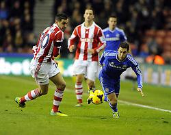 Chelsea's Eden Hazard takes the ball past Stoke City's Geoff Cameron - Photo mandatory by-line: Joe Meredith/JMP - Tel: Mobile: 07966 386802 07/12/2013 - SPORT - Football - Stoke-On-Trent - Britannia Stadium - Stoke City v Chelsea - Barclays Premier League