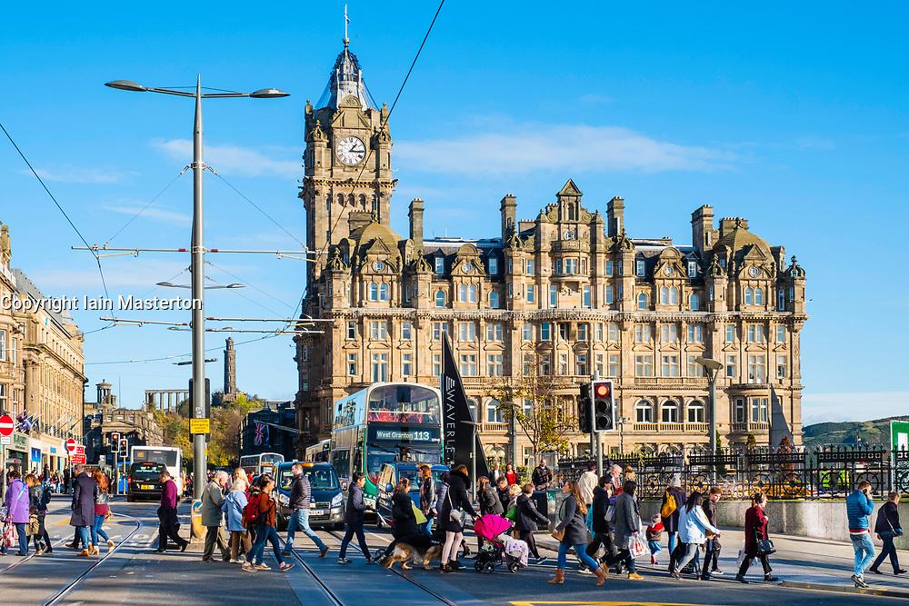 View along Princes street to the  Balmoral Hotel with busy pedestrian crossing Edinburgh , Scotland, United Kingdom.