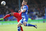 Joe Rafferty clears under pressure from Jamie Stott during the EFL Sky Bet League 1 match between Oldham Athletic and Rochdale at Boundary Park, Oldham, England on 22 April 2017. Photo by Daniel Youngs.
