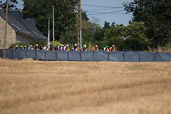 The peloton rolls past a wheat field in the third lap of the 121.5 km road race of the UCI Women's World Tour's 2016 Grand Prix Plouay women's road cycling race on August 27, 2016 in Plouay, France. (Photo by Balint Hamvas/Velofocus)