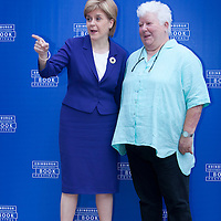 Nicola Sturgeon, First Minister of Scotland takes a selfie with Val McDermid, the Scottish crime writer, at the Edinburgh International Book Festival 2015.<br /> Edinburgh, Scotland. 26th August 2015 <br /> <br /> <br /> Photograph by Gary Doak/Writer Pictures<br /> <br /> WORLD RIGHTS