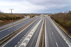 Edinburgh, Scotland, UK. 25 March, 2020. Day two of the Government enforced lockdown in the UK. All shops and restaurants and most workplaces remain closed. Cities are very quiet with vast majority of population staying indoors. Pictured; View of virtually deserted Edinburgh Bypass highway at Hermiston in Edinburgh.  Photo taken at what would be morning rush hour with heavy congestion. Iain Masterton/Alamy Live News