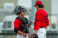 KELOWNA, BC - JULY 06:  Catcher Ezra Samperi stands on the pitchers mound with Garner Spoljaric #36 of the Kelowna Falcons against the Walla Walla Sweets at Elks Stadium on July 6, 2019 in Kelowna, Canada. (Photo by Marissa Baecker/Shoot the Breeze)