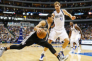 San Antonio Spurs shooting guard Danny Green (4) drives to the basket against Dallas Mavericks power forward Dirk Nowitzki (41) at American Airlines Center in Dallas, Texas, on January 25, 2013.  (Stan Olszewski/The Dallas Morning News)
