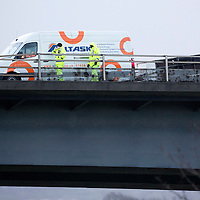Traffic chaos on the M90 motorway in Perth after a trailer was blown over by high winds on the Friarton Bridge….The photo shows Police at looking at the trailer…..29.01.16<br />