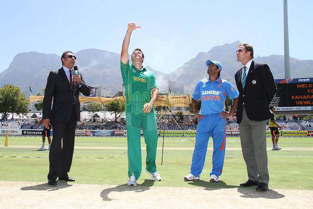South African captain Graeme Smith tosses the coin and Indian Captain Mahendra Singh Dhoni calls as commentator Ravi Shastri and Match Referee Chris Broad look on during the 3nd ODI between South Africa and India held at Sahara Park Newlands Stadium in Cape Town, Western Cape, South Africa on the 18th January 2011..Photo by Shaun Roy/BCCI/Sportzpics
