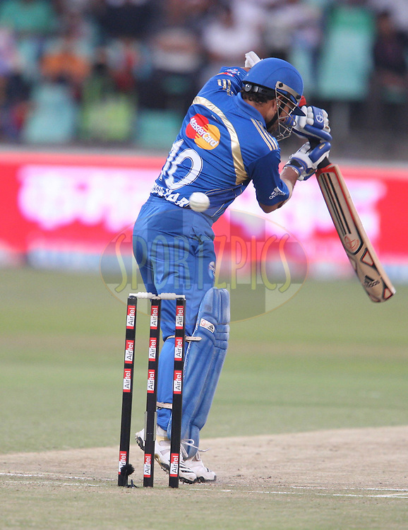 Play and a miss by Sachin Tendulkar during match 15 of the Airtel CLT20 between The Mumbai Indians and the Royal Challengers Bangalore held at Kingsmead Stadium in Durban on the 19 September 2010..Photo by: Steve Haag/SPORTZPICS/CLT20.
