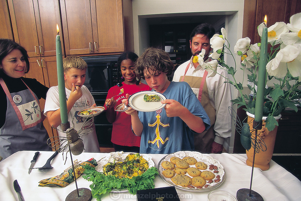 Safiya Carter-Thompson, 12, and two friends, Josh Olson and Alex Baker-Lubin, both 11, at an insect cooking lesson put on by entomologist Leslie Saul of the San Francisco Insect Zoo and her husband Norman Gershenz. On the menu: chocolate-chip mealworm cookies and cricket frittata. Berkeley, California, United States. (Man Eating Bugs page 184)