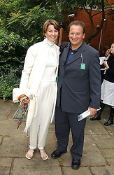 P Y GERBEAU and his fiance TV presenter KATE SANDERSON at the annual House of Lords v House of Commons tug of war match in aid of  of  Macmillan Cancer Relief on 22nd June 2004.  A drinks reception was held in College Gardens followd by the tug of war on Victoria Tower Gardens, London.