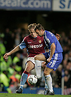 Photo: Marc Atkins.<br /> Chelsea v Aston Villa. Carling Cup. 08/11/2006.<br /> Andriy Shevchenko of Chelsea in action with Martin Laurson of Villa.