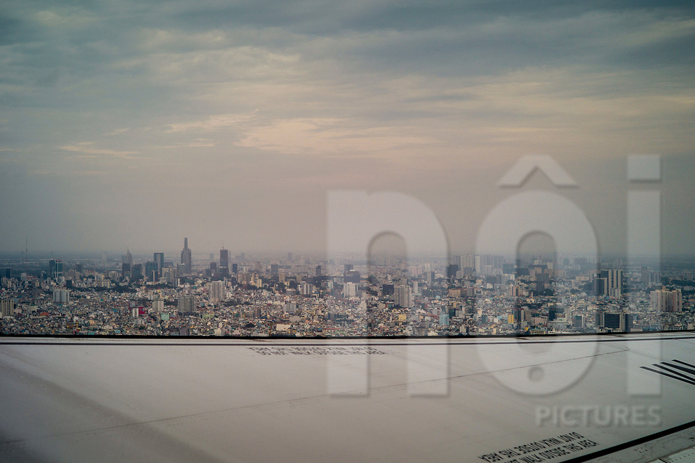Ho Chi Minh City skyline seen from an aircraft taking off, Vietnam, Southeast Asia