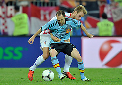 (L) Spain's Andres Iniesta (nr06) fights for the ball with (R) Croatia's Ivan Rakitic (nr07) during the UEFA EURO 2012 Group C football match between Spain and Croatia at Gdansk Arena in Gdansk on June 18, 2012...Poland, Gdansk, June 18, 2012..Picture also available in RAW (NEF) or TIFF format on special request...For editorial use only. Any commercial or promotional use requires permission...Photo by © Adam Nurkiewicz / Mediasport