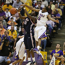 14 February 2009 LSU guard Marcus Thornton (5) blocks a shot by Malcolm White (21) of Ole Miss during 73-66 win by the LSU Tigers against SEC rival the Ole Miss Rebels at the Pete Maravich Assembly Center in Baton Rouge, LA.