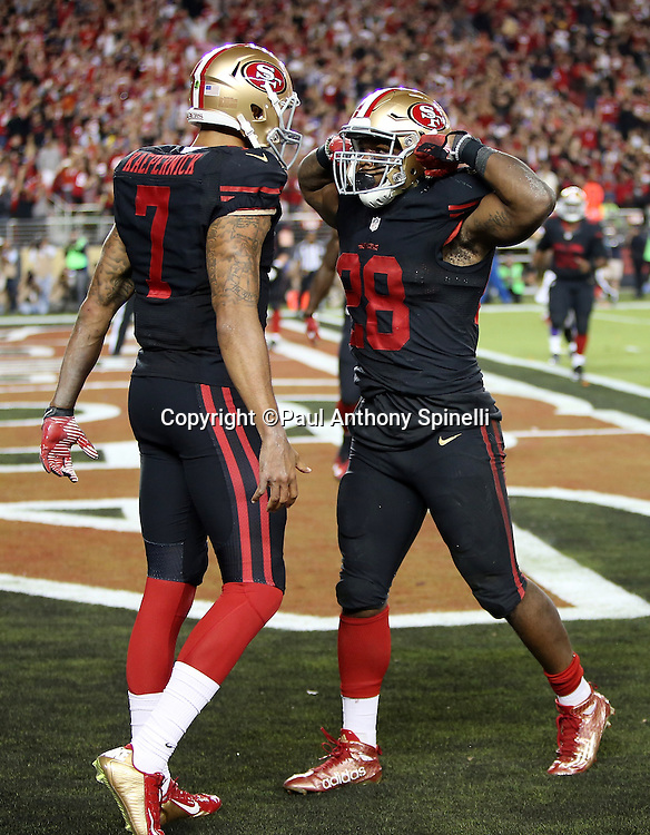 San Francisco 49ers quarterback Colin Kaepernick (7) celebrates with San Francisco 49ers running back Carlos Hyde (28) after Hyde runs for a second quarter touchdown of 10 yards and a 7-0 Niners lead during the 2015 NFL week 1 regular season football game against the Minnesota Vikings on Monday, Sept. 14, 2015 in Santa Clara, Calif. The 49ers won the game 20-3. (©Paul Anthony Spinelli)