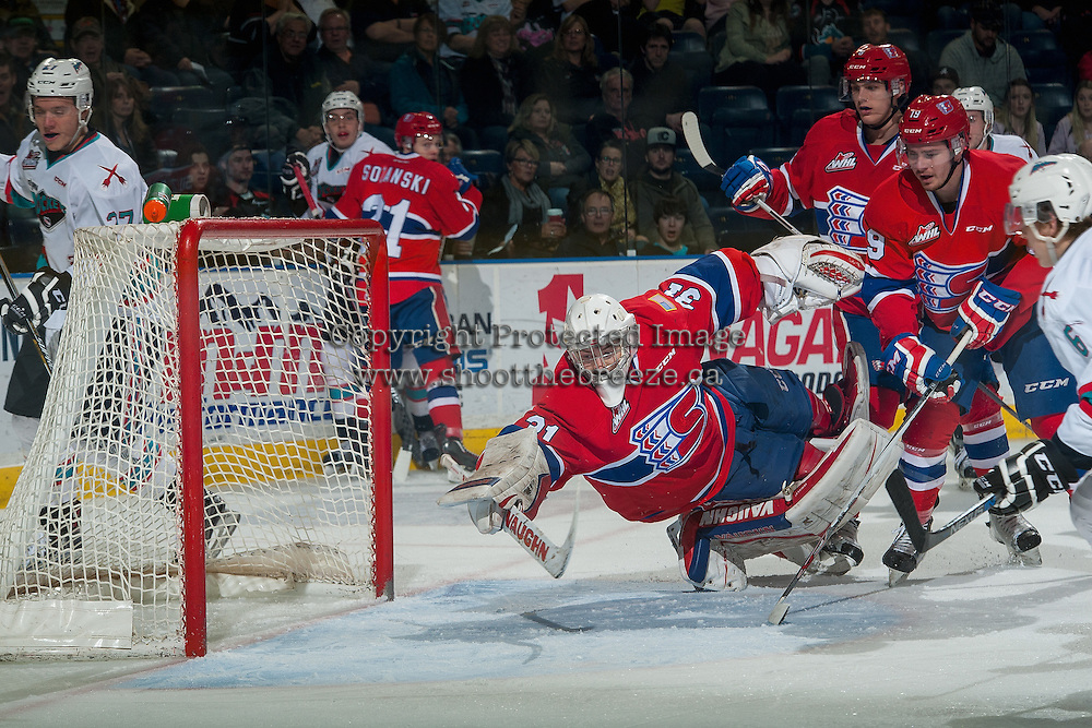 KELOWNA, CANADA - FEBRUARY 27: Jonathan Smart #6 of Kelowna Rockets scores his second WHL goal against Tyson Verhelst #31 of Spokane Chiefs during the first period on February 27, 2016 at Prospera Place in Kelowna, British Columbia, Canada.  (Photo by Marissa Baecker/Shoot the Breeze)  *** Local Caption *** Jonathan Smart; Tyson Verhelst;