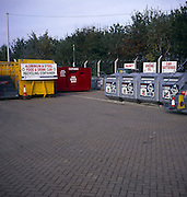 Recycling containers for batteries, engine oil, paint and metal can, Foxhall, Suffolk, England