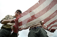 CHURCHVILLE, PA - JUNE 14: Lucas Williams (L), 14 and Sean Healy, 17 of Boy Scout Troop 5 of Churchville cut the stripes to properly dispose of American flags during a ceremony June 14, 2014 at Northampton Township Municipal Park in Churchville, Pennsylvania. The Northampton supervisors and Veterans Advisory Committee held the ceremony in which people brought their old or tattered American flags for proper disposal.  (Photo by William Thomas Cain/Cain Images)