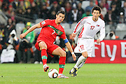 CAPE TOWN, SOUTH AFRICA, MONDAY 21 June 2010, Cristiano Ronaldo of Portugal gets challenged by AN Yong Hak during the match between Portugal and Korea PRK held at the new Cape Town Stadium in Green Point during the 2010 FIFA World Cup..Photo by Roger Sedres/Image SA
