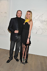 NOELLE RENO and SCOT YOUNG at a private view of Fly to Baku - Contemporary Art from Azerbaijan held at Phillips de Pury, Howick Place, London SW1 on 17th January 2012.