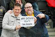 MK Dons fans with 'we'll be back' sign after the EFL Sky Bet League 1 match between Milton Keynes Dons and Scunthorpe United at stadium:mk, Milton Keynes, England on 28 April 2018. Picture by Nigel Cole.