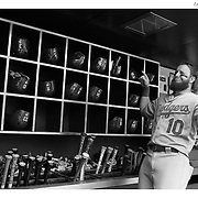 Justin Turner, Los Angeles Dodgers, jokes in the dugout with team mates as he prepares to bat before the New York Mets Vs Los Angeles Dodgers MLB regular season baseball game at Citi Field, Queens, New York. USA. 26th July 2015. Photo Tim Clayton