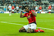 Paul Pogba (#6) of Manchester United reacts after missing an opportunity following taking the ball around Martin Dubravka (#12) of Newcastle United but missing the target during the Premier League match between Newcastle United and Manchester United at St. James's Park, Newcastle, England on 2 January 2019.