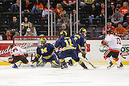 November 21, 2009:  BGSU's Josh Boyd (26),Michigan goaltender Bryan Hogan (35), Michigan's Kevin Lynch (11) and Michigan defender Steve Kampfer (5) during the NCCA hockey game between Michigan and the Bowling Green State University at Lucas County Arena in Toledo, Ohio. during the NCCA hockey game between Michigan and the Bowling Green State University at Lucas County Arena in Toledo, Ohio.