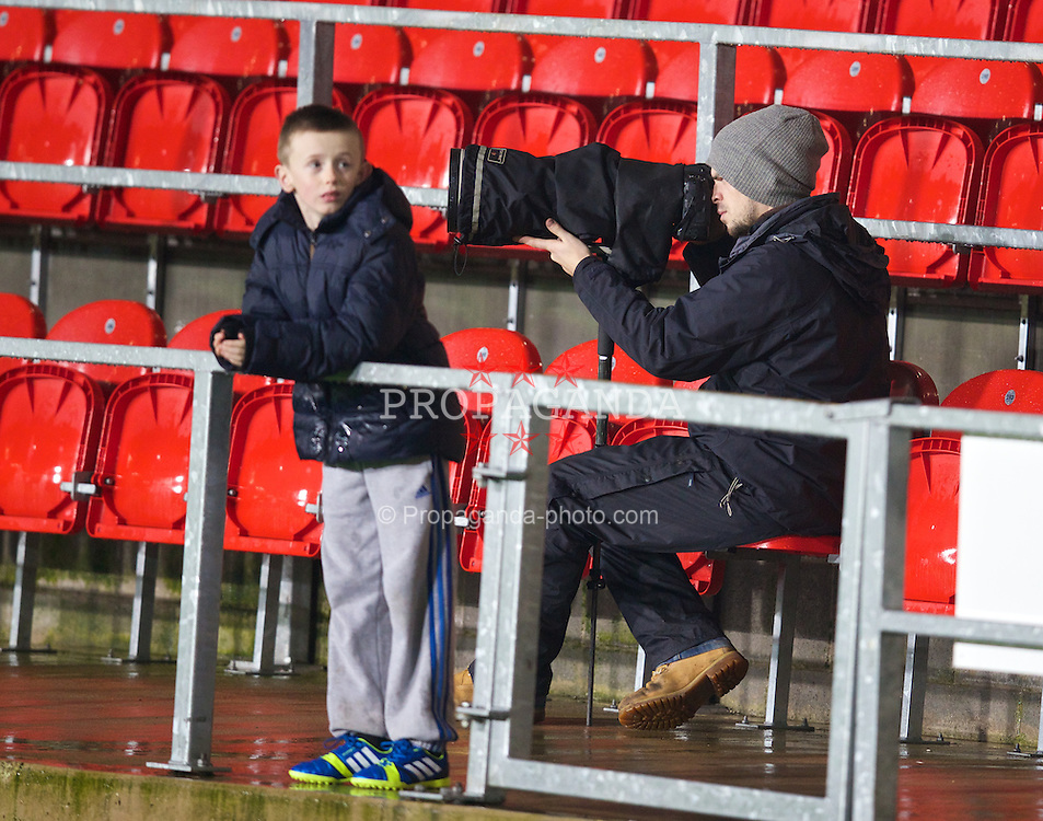 ST. HELENS, ENGLAND - Wednesday, January 15, 2014: Photographer Simon Stackpool during the FA Youth Cup 4th Round match at Langtree Park. (Pic by David Rawcliffe/Propaganda)