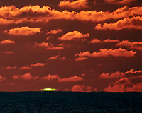 """""""Green Flash"""" as the sun drops into the Sea from the Deck of the MV World Odyssey. Image taken with a Nikon 1 V3 camera and 70-300 mm lens (ISO 200, 300 mm, f/11, 1/250 sec)."""