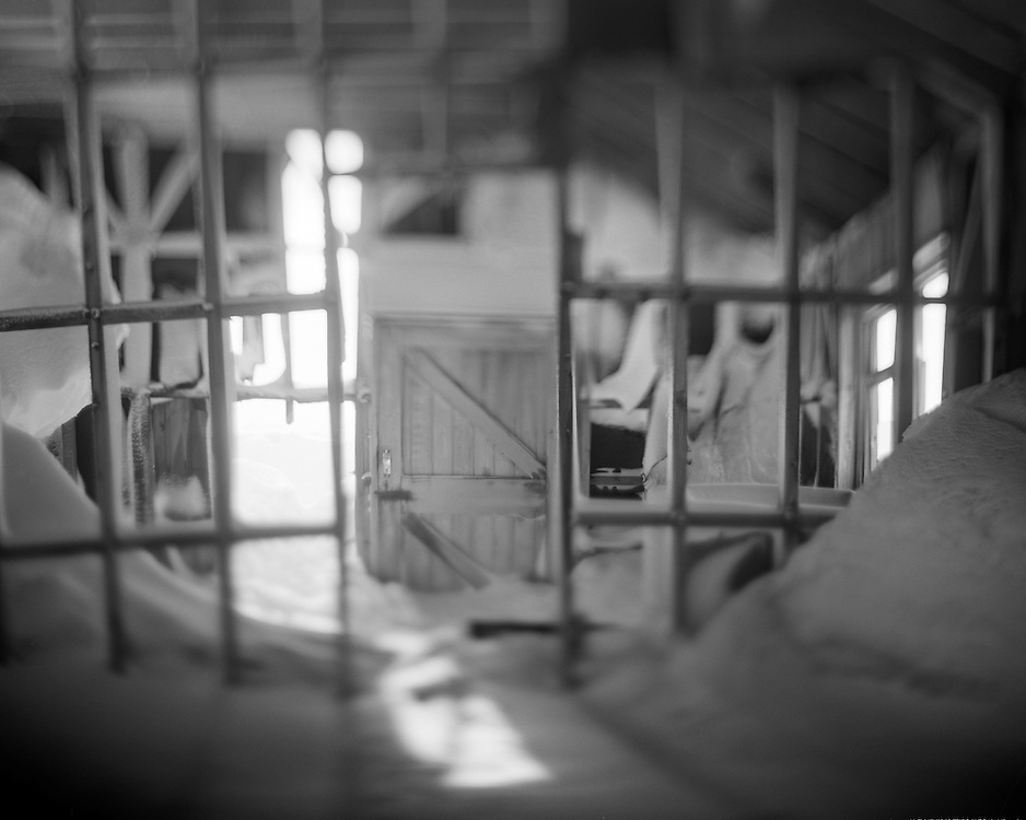 Antarctica, Deception Island, Blurred black and white image of snow-filled interior of abandoned wooden building at Whalers Cove
