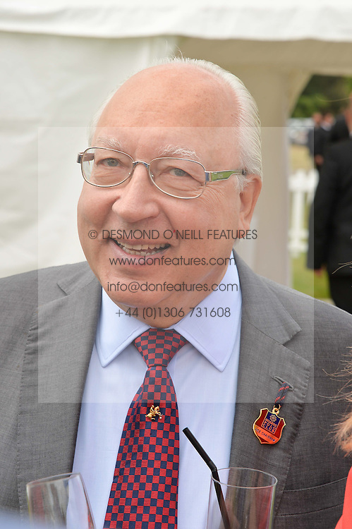 URS SCHWARZENBACH at the Cartier Queen's Cup Polo final at Guard's Polo Club, Smiths Lawn, Windsor Great Park, Egham, Surrey on 14th June 2015