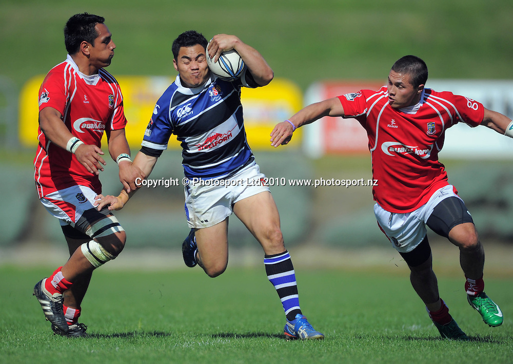 Wanganui winger Ace Malo tries to break between Pomare Samupo and Whaimotu Craft-Chemis. AA Rewards Heartland Championship - Meads Cup match between Wanganui and Poverty Bay  at Cooks Gardens, Wanganui on Saturday, 11 September 2010. Photo: Dave Lintott/photosport.co.nz