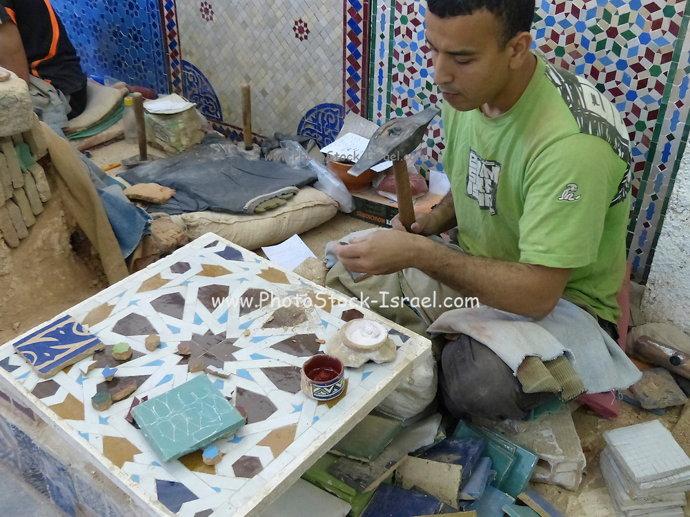 Morocco, Fez, an artisan creates tile designs