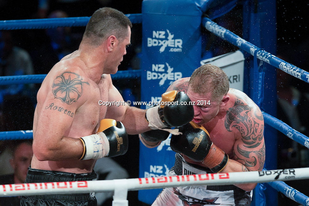 Kali `Mean Hands` Meehan (L) fights Shane `The Mountain Warrior` Cameron in the Mahindra Super 8 Fight Night, North Shore Events Centre, Auckland, New Zealand, Saturday, November 22, 2014. Photo: David Rowland/Photosport