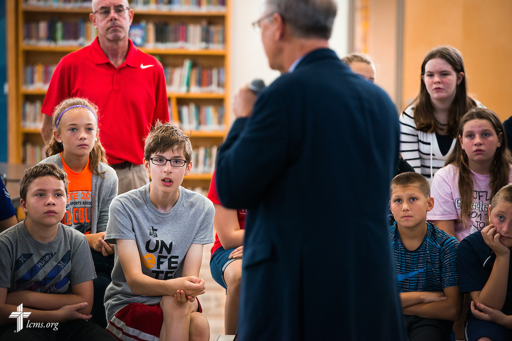 Students listen as the Rev. Dr. James Lamb, retiring executive director of Lutherans for Life, leads an Owen's Mission presentation at Trinity Lutheran School on Monday, August 31, 2015, in Bloomington, Ill. LCMS Communications/Erik M. Lunsford