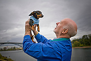 Photographs of lifestyle on the South Waterfront area of Portland, Oregon. Senior citizen with Dachshund.