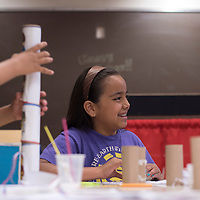 070215      Cayla Nimmo<br /> <br /> Sabrina John makes superhero themes mini bowling pins during the crafty kids hosted at Octavia Fellin Library Children's Branch in Gallup Thursday.