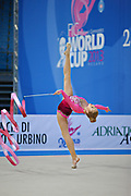 Mateva Mariya during qualifying at ribbon in Pesaro World Cup at Adriatic Arena on 27 April 2013. Mariya was born on June 1,1994 in Burgas. She is a Bulgarian individual rhythmic gymnast.