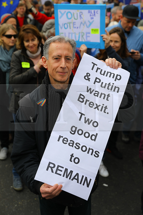© Licensed to London News Pictures. 23/03/2019. London, UK.  Peter Tatchell joins protesters taking part in a People's Vote protest march in central London today, to demand a people's vote (second referendum) on whether Britain should remain in the European Union. Prime Minister, Theresa May has negotiated an extension to the Brexit timetable with the European Union and is now expected to hold a third meaningful vote on her Brexit deal in parliament next week.  Photo credit: Vickie Flores/LNP
