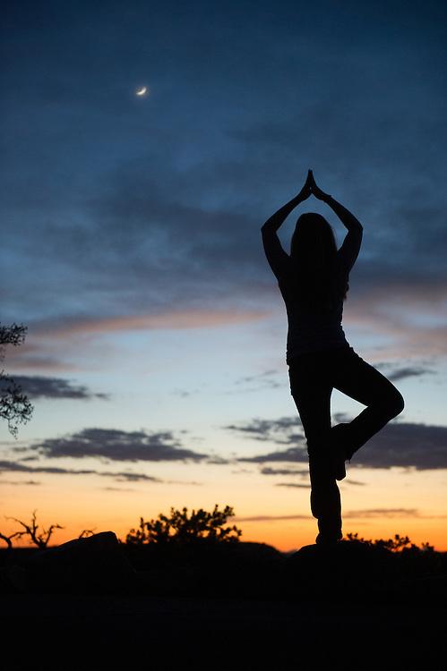 Woman Doing Yoga Pose at Grand Canyon Sunset