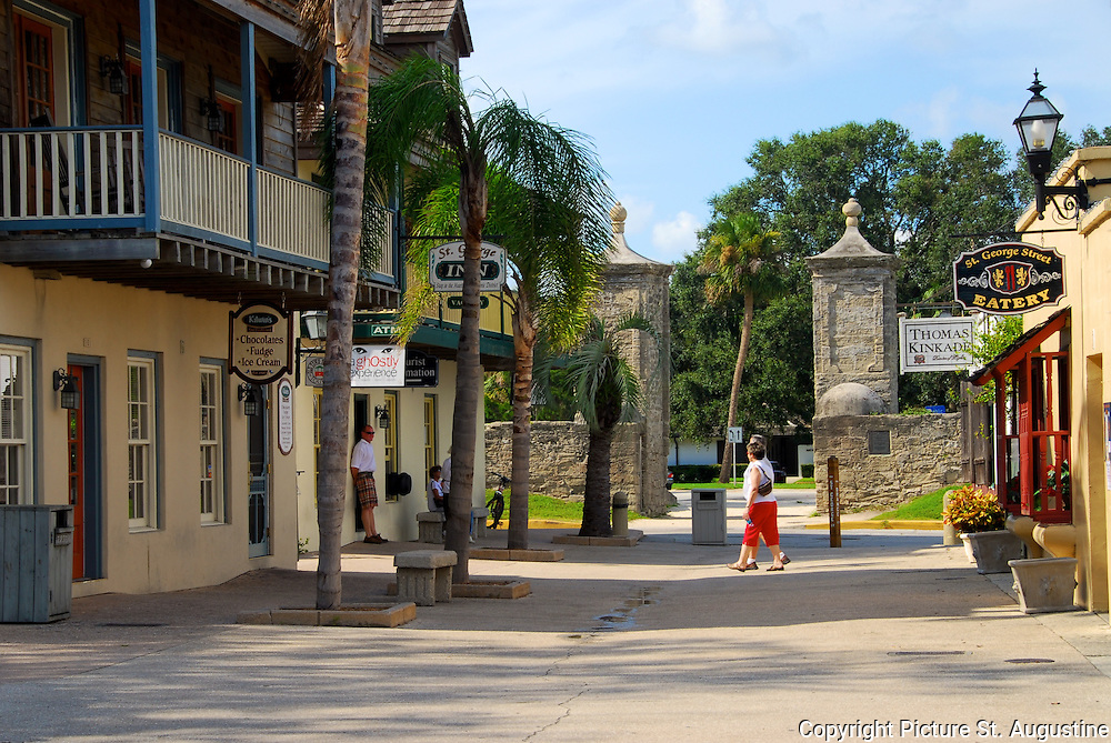 Visitors take a late afternoon stroll down St. George Street going toward the City Gates in St. Augustine, Florida. St. George Street was the main thoroughfare through the colonial city and is still considered the heart of St. Augustine. Here you will find some of the historical attractions, restaurants, galleries and shopping that St. Augustine is known for. St. Augustine is the oldest continually occupied European city in the United States.