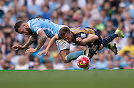 Nicolas Otamendi of Manchester City (left) and Aaron Ramsey of Arsenal challenge for the ball during the Barclays Premier League match at the Etihad Stadium, Manchester<br /> Picture by Russell Hart/Focus Images Ltd 07791 688 420<br /> 08/05/2016