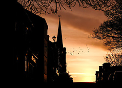 © Licensed to London News Pictures. <br /> 26/03/20167. <br /> Saltburn by the Sea, UK.  <br /> <br /> A spectacular sunrise starts the day over Milton Street in Saltburn by the Sea.<br /> <br /> Photo credit: Ian Forsyth/LNP