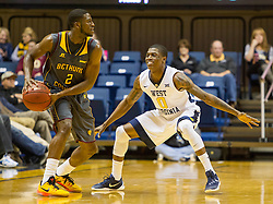 Nov 23, 2015; Morgantown, WV, USA; West Virginia Mountaineers guard Teyvon Myers guards Bethune-Cookman Wildcats guard Diamante Lewis during the first half  at WVU Coliseum. Mandatory Credit: Ben Queen-USA TODAY Sports